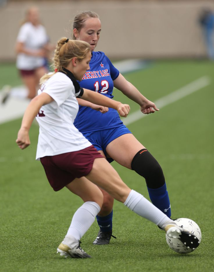 Midlothian Heritage's Kylar Kenter (12) goes up against Calallen's Hannah Brittain (22) during their UIL 4A girls State championship soccer game at Birkelbach Field on April 16, 2021 in Georgetown, Texas.  (Thao Nguyen/Special Contributor)