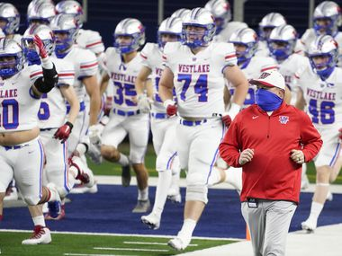Austin Westlake head coach Todd Dodge takes the field with his team for the Class 6A Division I state football championship game against Southlake Carroll  at AT&T Stadium on Saturday, Jan. 16, 2021, in Arlington, Texas.