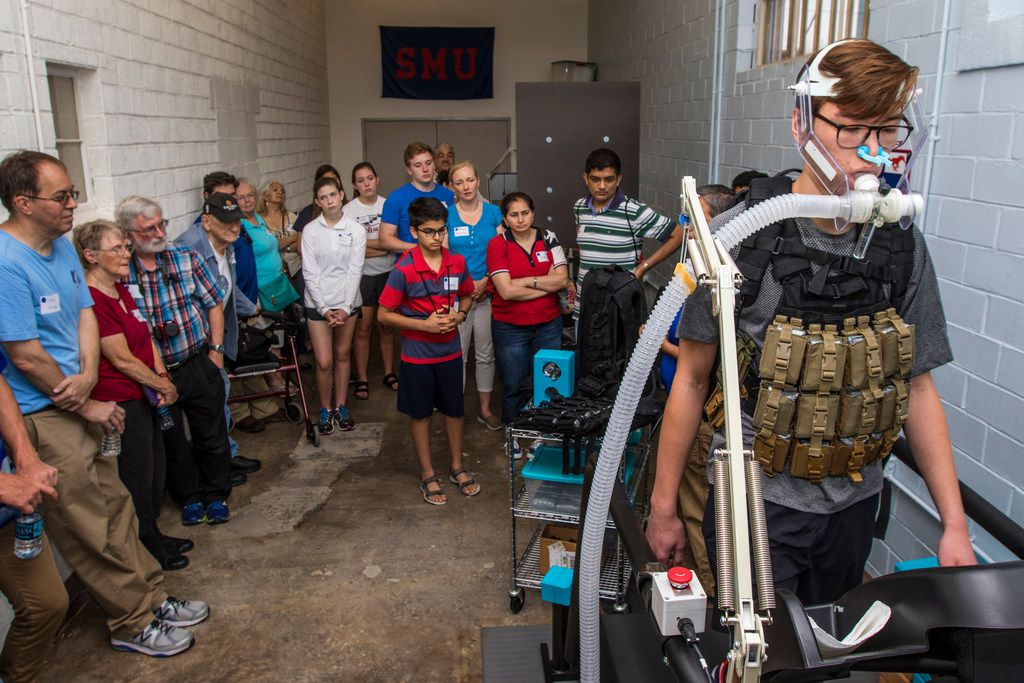 A research assistant demonstrates a breathing task during Science in the City at Southern Methodist University on Saturday.