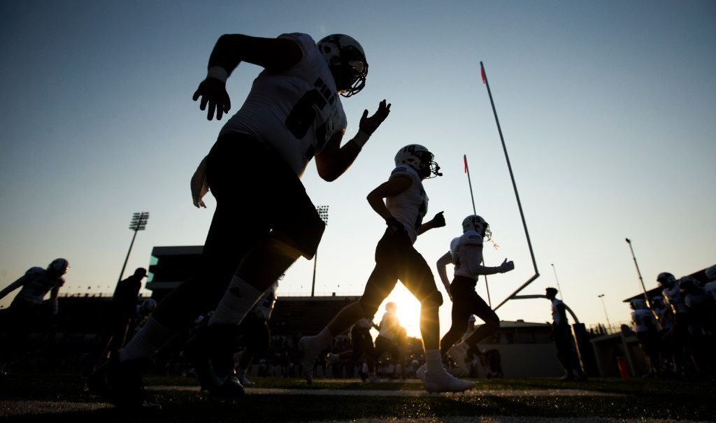Mesquite Poteet football players warm up before a high school football game between Mesquite Poteet and Denton Ryan on Friday, September 8, 2017 at Collins Athletic Complex in Denton, Texas. (Ashley Landis/The Dallas Morning News)