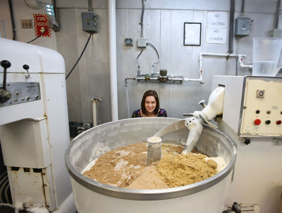 This isn't Honey, I Shrunk the Kids. That's reporter Sarah Blaskovich behind one of the giant mixers at Empire Baking Company in 2018. The bakery remains on University Boulevard in Dallas, but it added a grab-and-go store in April 2021.