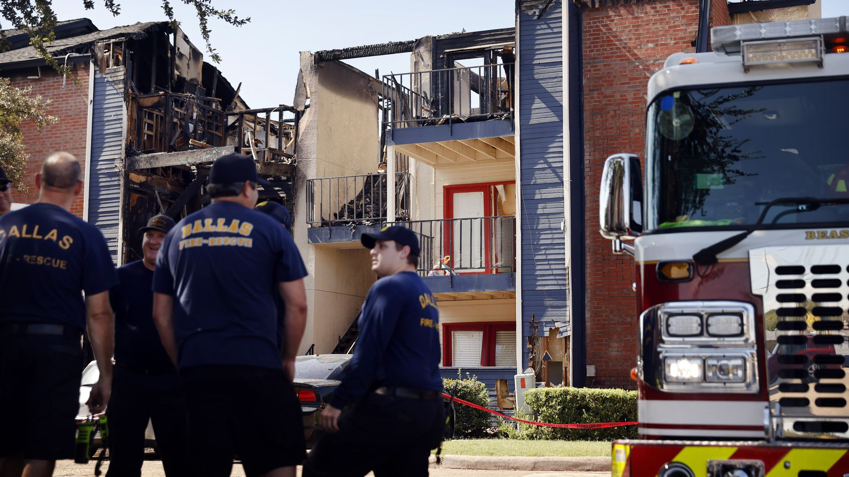 Dallas firefighters keep watch over the burned out, three-story apartment building at the Oak Meadows Apartments on Woodmeadow Parkway in Dallas Thursday, September 16, 2021. Of the 24 apartments in the building, 12 sustained damage. The rest were uninhabitable because of water and smoke, Dallas Fire-Rescue spokesperson Jason Evans said. One of the units in the building was not occupied. One resident was taken to a hospital with burns that were not believed to be life-threatening. He was hurt while he was trying to escape the building. The fire happened early Thursday morning. (Tom Fox/The Dallas Morning News)