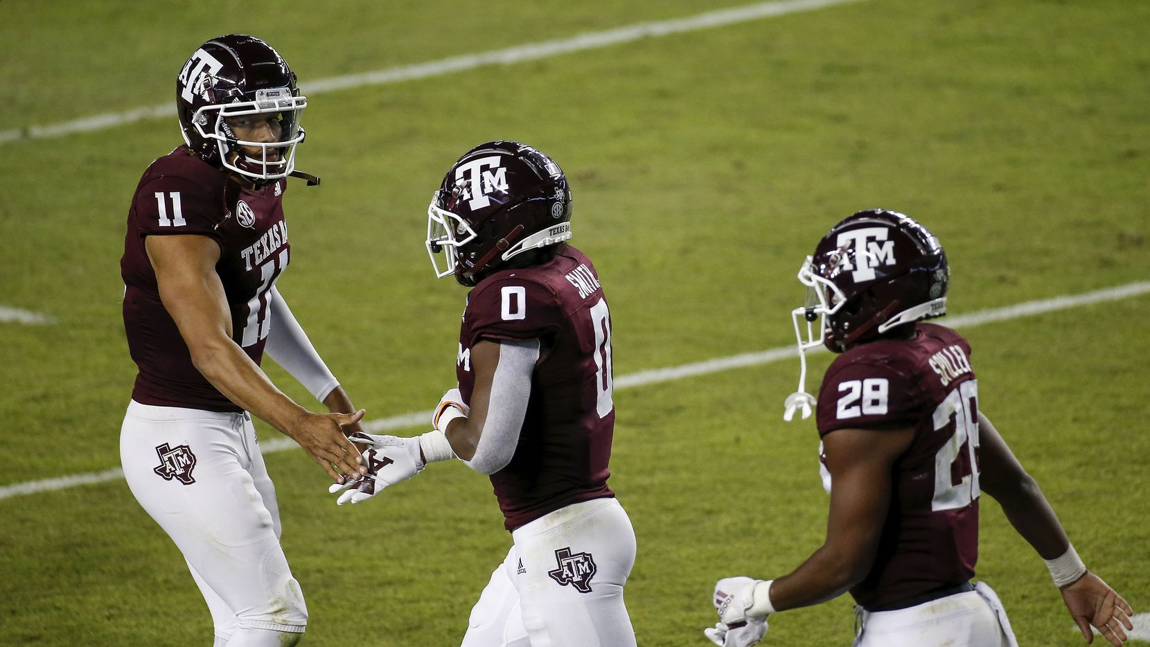 Texas A&M quarterback Kellen Mond (11) congratulates running back Ainias Smith (0) after a touchdown in the first quarter against Arkansas at Kyle Field on Oct. 31, 2020, in College Station.