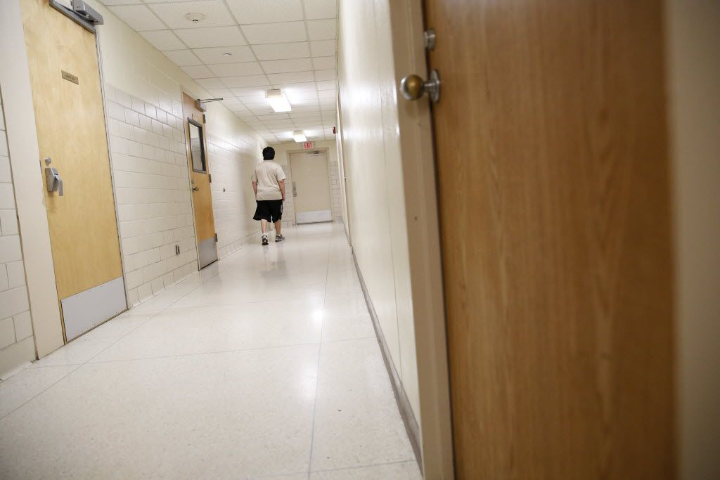 A patient walks down the hallway in the forensic ward at the Terrell State Hospital in Terrell, Texas on April 21, 2016. (Rose Baca/The Dallas Morning News)