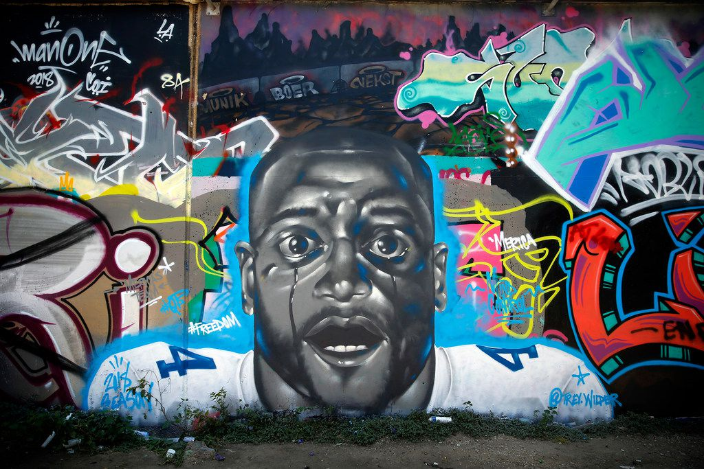 Artist Trey Wilder painted a mural including Dallas Cowboys quarterback Dak Prescott on one of the Fabrication Yard graffiti walls in West Dallas, Saturday, August 4, 2018. The face appears to be a morph between the Get Out movie character and the Cowboys player.