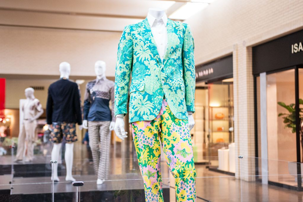 Shoppers will have to wait awhile to take in Bloom Men, a new exhibit of floral menswear from the 1700s to the 1970s at NorthPark Center through May 17. The clothing is from the Texas Fashion Collection at the University of North Texas College of Visual Arts & Design.