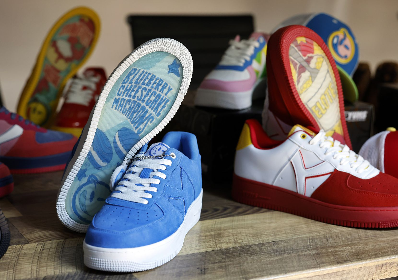 The newest collection of YUMS sneakers on display at Already Design Co.'s Arlington offices. The popular mid-2000s streetwear brand is relaunching after recovering from a legal battle with Nike.