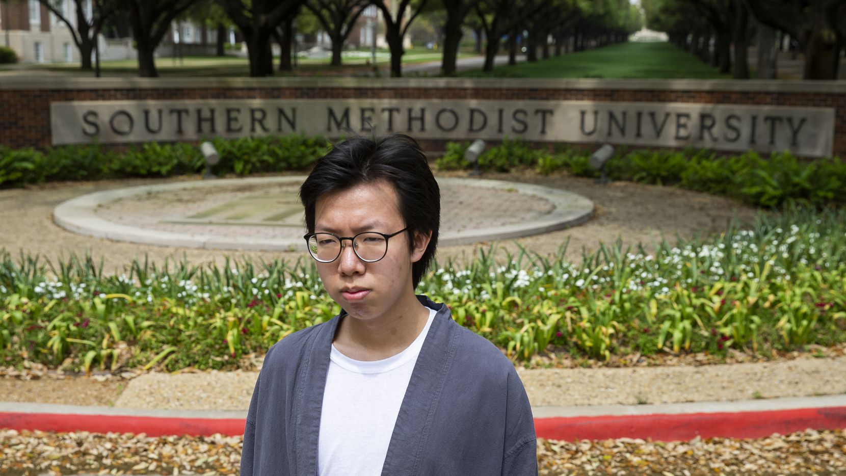Yuanhao Dou, a freshman at Southern Methodist University, is desperately trying to get back home to China unsure if future travel restrictions will make it impossible. He's among thousands of international students in Texas stuck in limbo amid coronavirus concerns. (Juan Figueroa/ The Dallas Morning News)