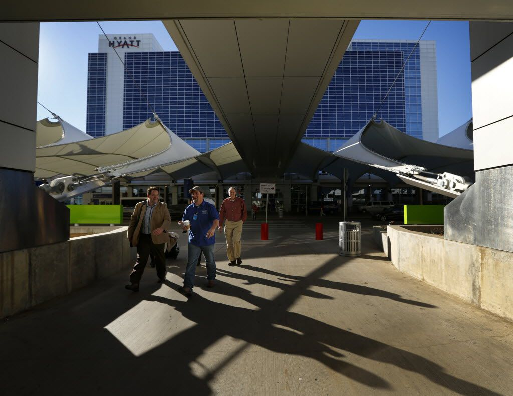Passengers and their rides head for the Terminal D parking garage outside the Grand Hyatt hotel at Dallas Fort Worth International Airport, Thursday, January 17, 2013. The airport approved a plan to build a new Hyatt hotel.