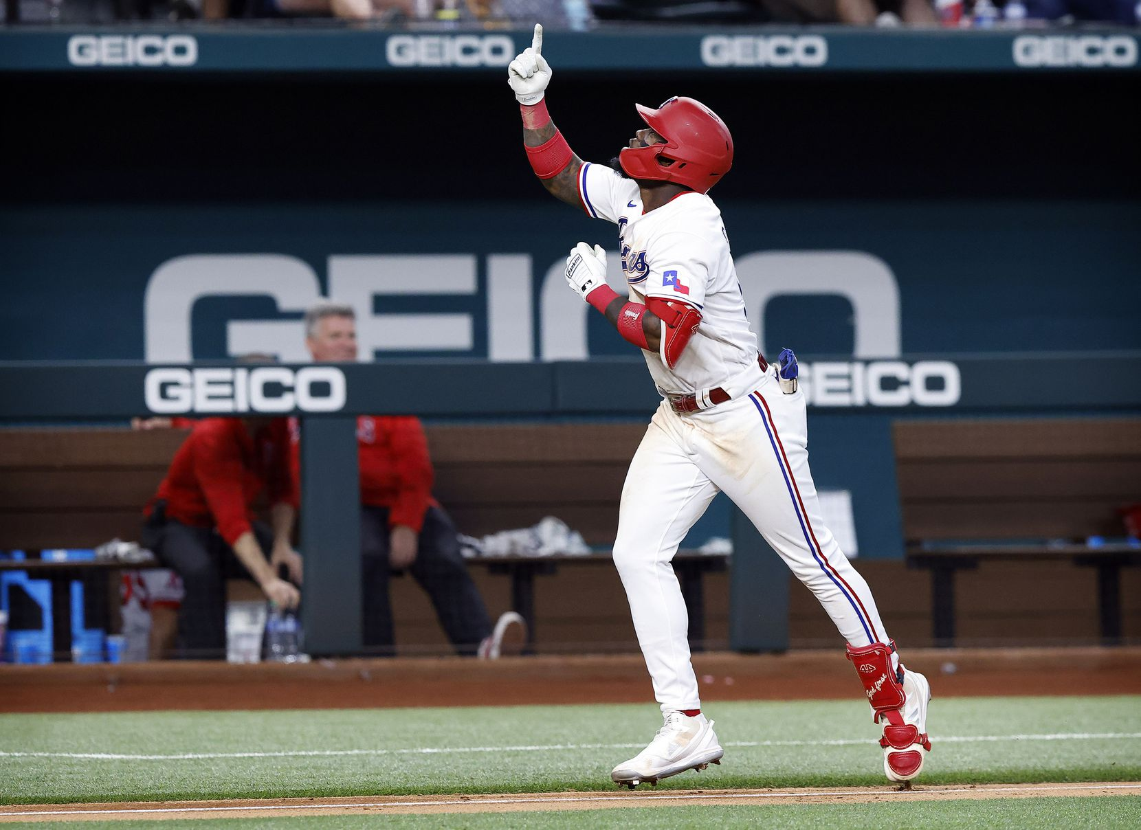 Texas Rangers batter Adolis Garcia points skyward as he heads for home on a two-run homer, a new Rangers rookie record for home runs and RBIs, during the fifth inning against the Los Angeles Angels at Globe Life Field in Arlington, Texas, Thursday, September 30, 2021. (Tom Fox/The Dallas Morning News)