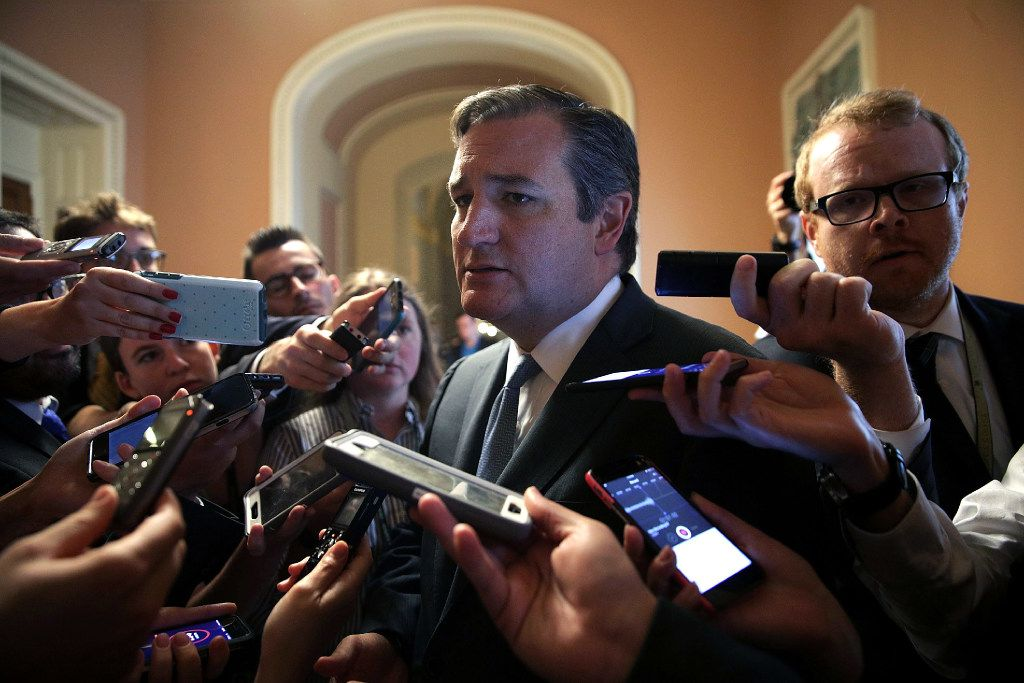 WASHINGTON, DC - JULY 13:  U.S. Sen. Ted Cruz (R-TX) is surrounded by members of the media after he viewed the details of a new health care bill July 13, 2017 at the Capitol in Washington, DC. Senate Majority Leader Mitch McConnell (R-KY) has releaseed a new Republican health care plan today.