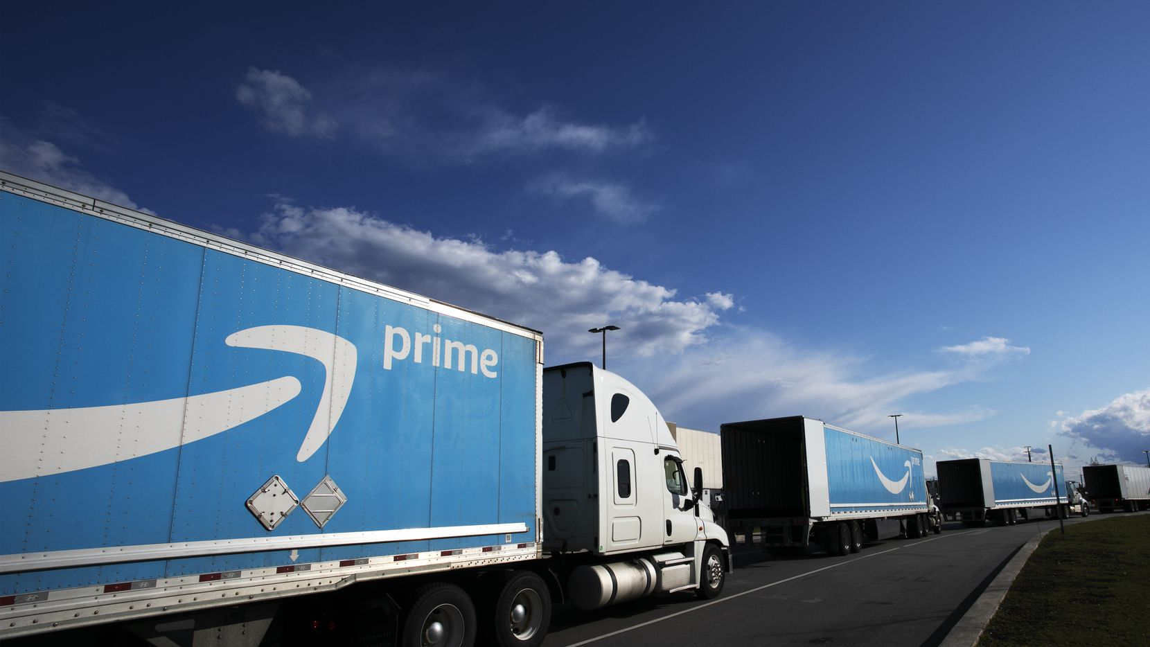 This 2020 file photo shows Amazon tractor trailers lined up outside the Amazon Fulfillment Center in the Staten Island borough of New York.  The District of Columbia has sued Amazon Tuesday, accusing the online retail giant of illegal anticompetitive practices in its treatment of sellers on its platform.