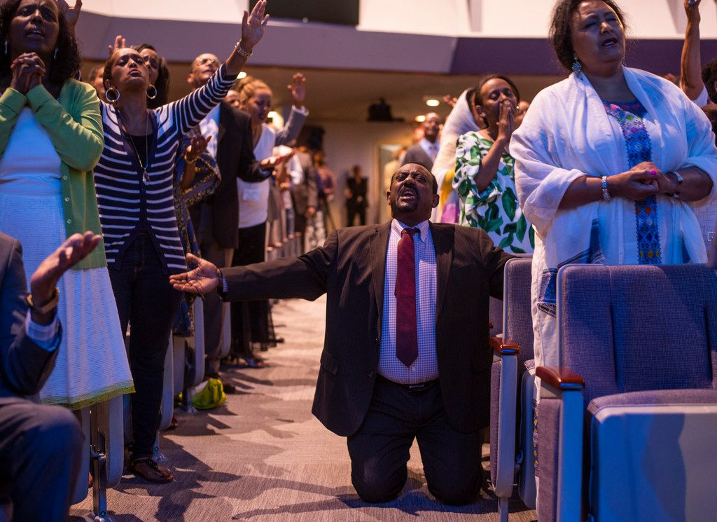 The congregation prays  at the Ethiopian Evangelical Baptist Church in Garland.