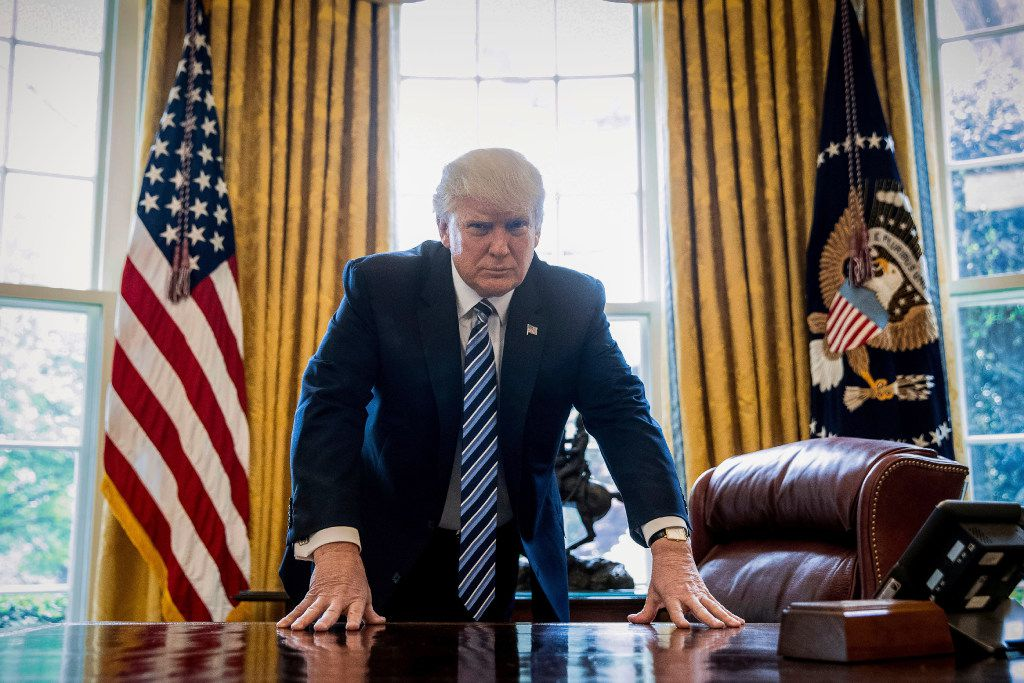 President Donald Trump poses for a portrait in the Oval Office in Washington, Friday, April 21, 2017. (Andrew Harnik/The Associated Press)