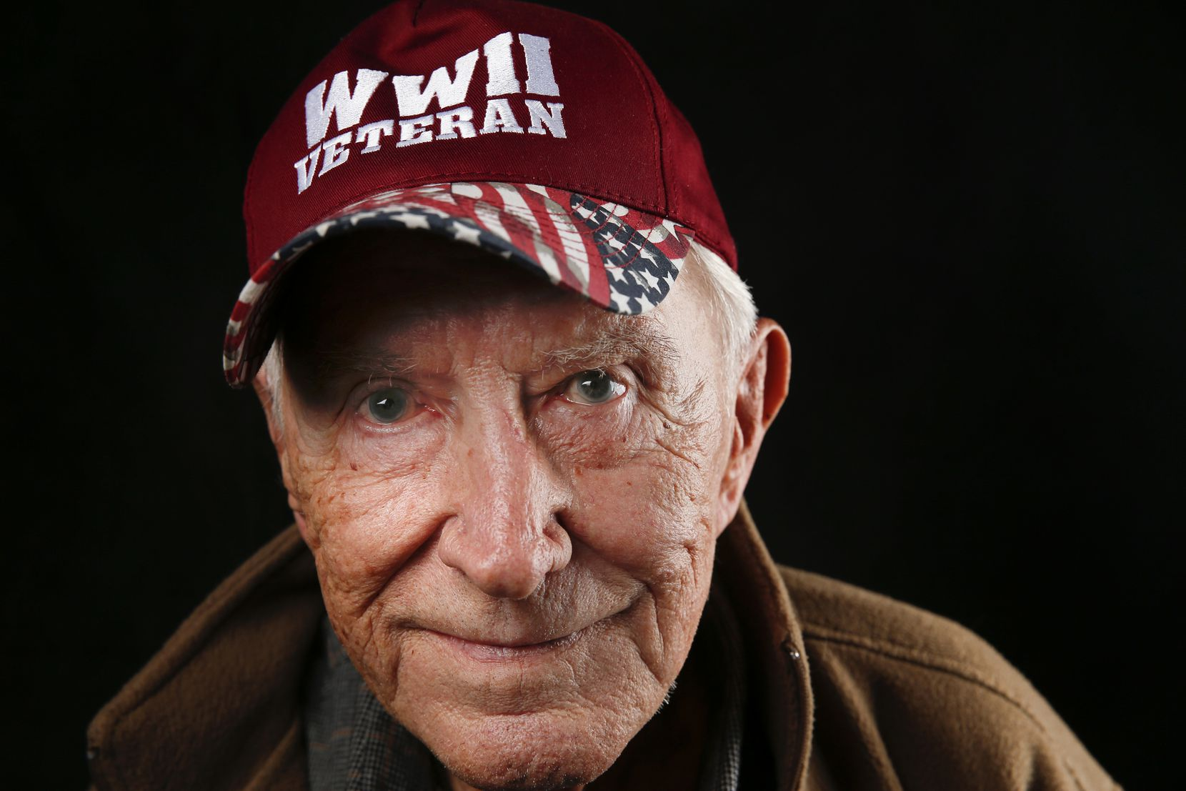 Barney Baker, 94, of Arlington, Texas, a private who served as a World War II top gunner on a tank destroyer, is photographed during the Wings Over Dallas Airshow on Saturday, Oct. 26, 2019 in Dallas.