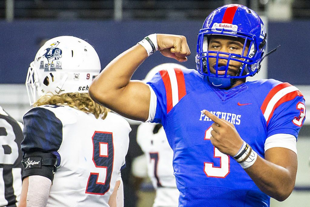 Duncanville quarterback Ja'quinden Jackson flexes after running 40-yards for a touchdown to break open a 35-35 tie game on a 4th-and-two play during the fourth quarter of a Class 6A Division IÊstate semifinal as Allen linebacker Luke Jaksick (9) walks off the field at AT&T Stadium on Saturday, Dec. 15, 2018, in Arlington. (Smiley N. Pool/The Dallas Morning News)