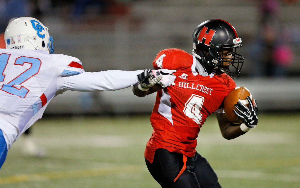 Hillcrest High running back Nasir Reynolds (4) shakes a tackle by Carter High linebacker Chase Kelly (42) during the second quarter at Hillcrest's Franklin Stadium in Dallas, Thursday, October 18, 2018. (Tom Fox/The Dallas Morning News)