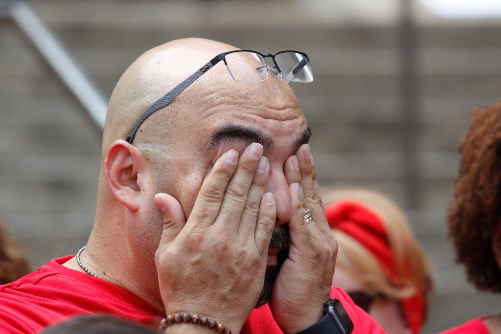 Juan Gonzales wipes tears from his eyes during a rally held Saturday May 13, 2017 on the steps Frank Crowley Courts Building during a rally remembering those killed by police. He was there in memory of his son, Jordan Love Gonzales, who was killed in October in Corpus Christi, Texas.
