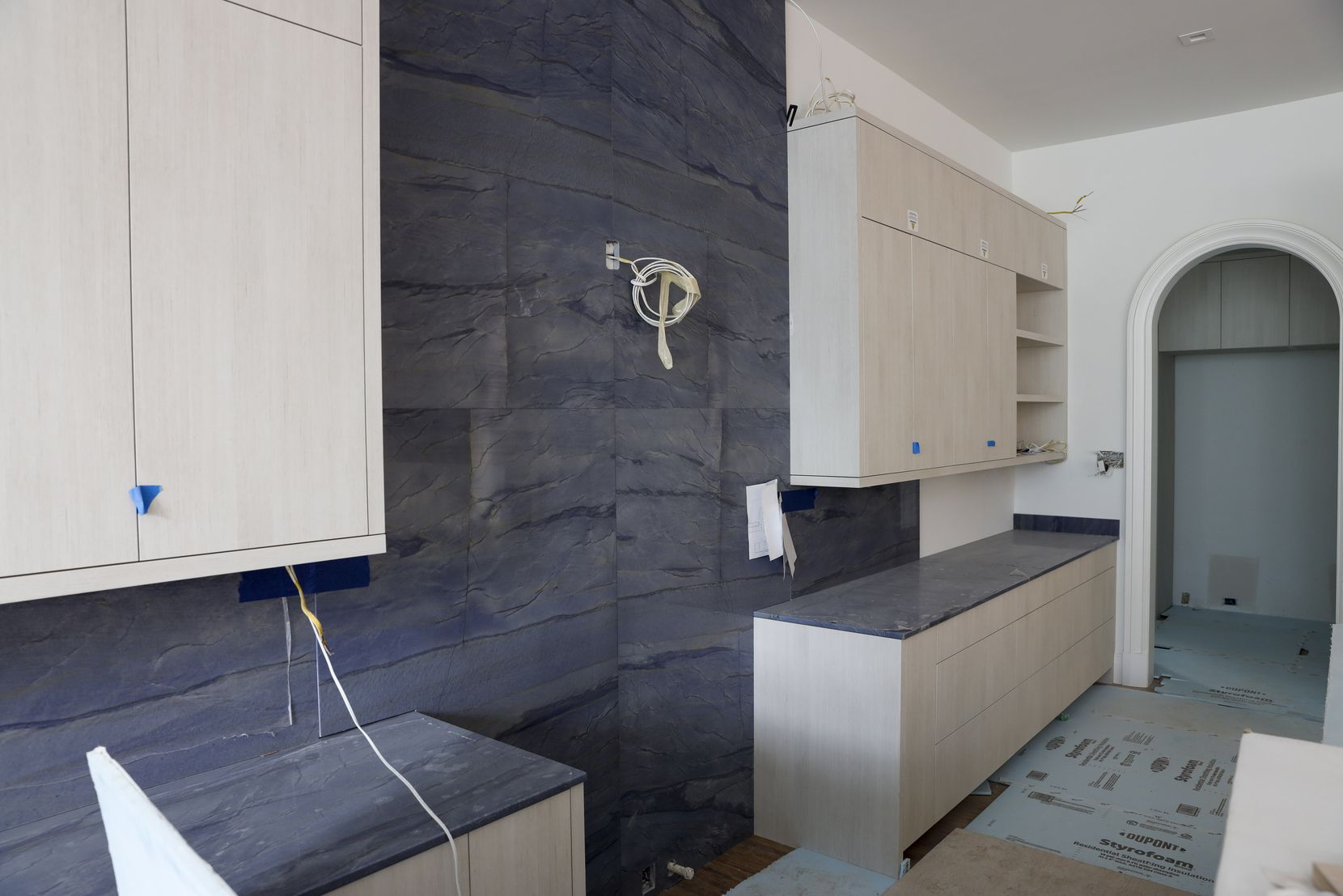 Azul macaubas lines the counters and backsplash in the kitchen.