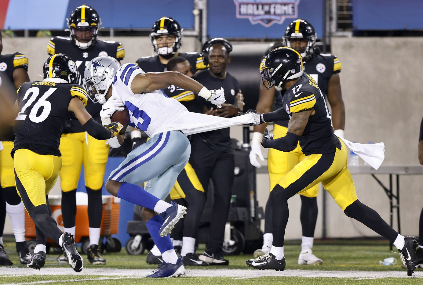 Dallas Cowboys wide receiver Brennan Eagles (83) is slowed by Pittsburgh Steelers cornerback Mark Gilbert (17) following a fourth quarter pass completion during their preseason game at Tom Benson Hall of Fame Stadium in Canton, Ohio, Thursday, August 5, 2021. (Tom Fox/The Dallas Morning News)