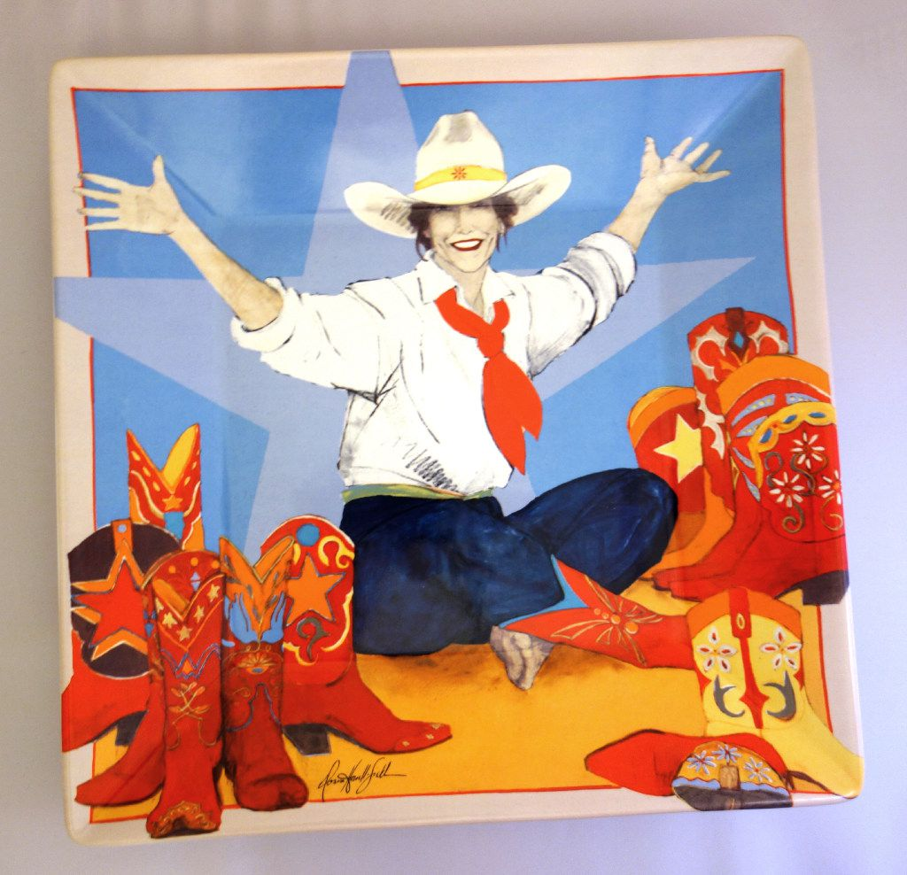 "Cowgirl up with this vivid porcelain platter showing Donna Howell-Sickles' ""World at Her Feet."" It's from the National Cowgirl Museum and Hall of Fame."