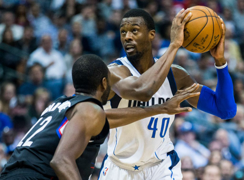 Dallas Mavericks forward Harrison Barnes (40) looks up at the basket over LA Clippers forward Luc Mbah a Moute (12) during the second quarter of their game on Wednesday, November 23, 2016 at the American Airlines Center in Dallas.  (Ashley Landis/The Dallas Morning News)