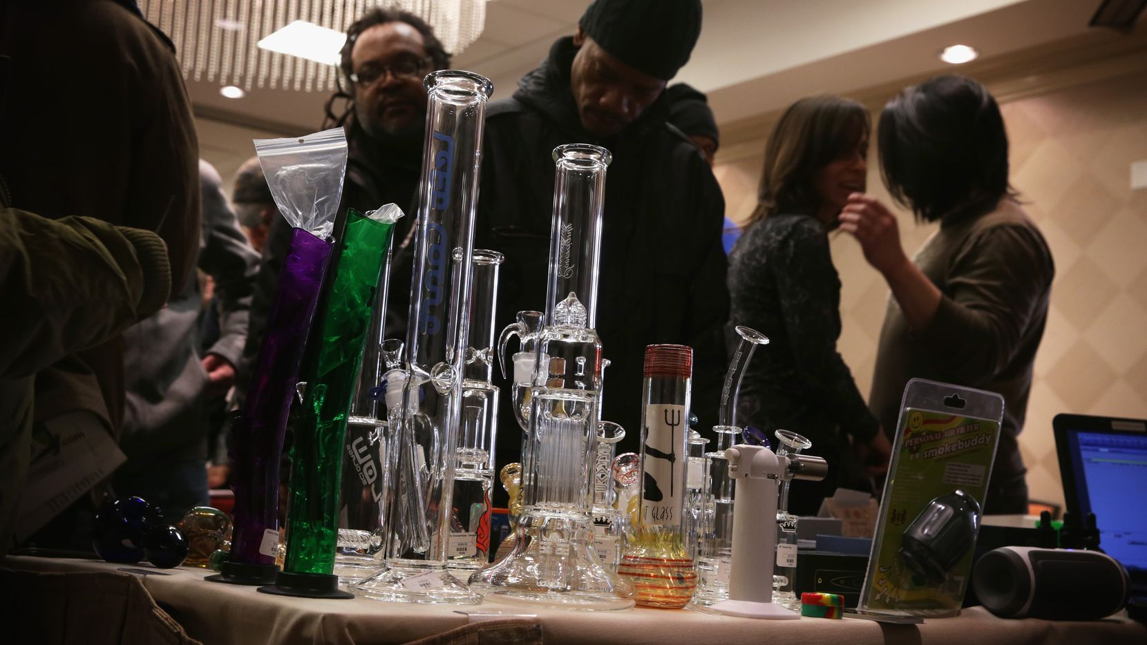 Attendees check out smoking pipes during a ComfyTree Cannabis Academy conference February 28, 2015 in Washington, DC. City council members in Mesquite recently approved stronger regulations on the sale of smoking paraphernalia in city limits.