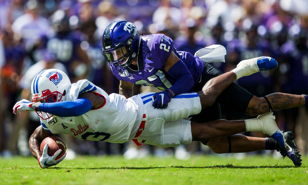 Southern Methodist Mustangs wide receiver James Proche (3) dives for extra yardage while being tackled by TCU Horned Frogs safety Ar'Darius Washington (27) during the first quarter of a college football game between SMU and TCU on Saturday, September 21, 2019 at Amon G. Carter Stadium in Fort Worth.