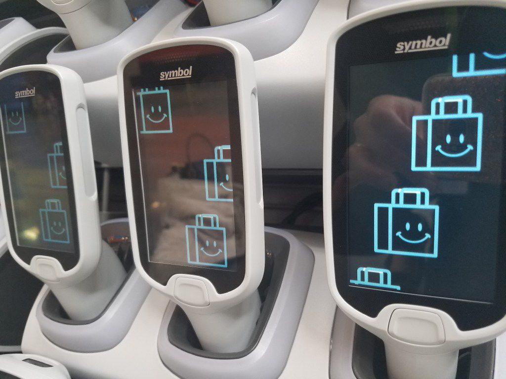 Wal-Mart s Scan & Go system of handheld scanners will be added to 10 Wal-Mart stores in North Texas this weekend. Dallas-Fort Worth area Sam s Clubs have had the scan-as-you-shop system since October.  The system also works from a Scan & Go app customers can download to iPhone and Android smartphones.