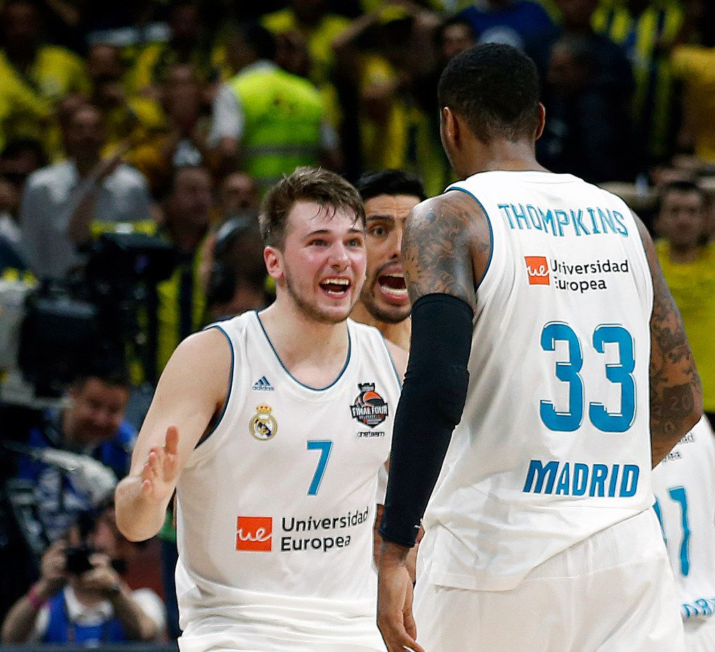 Real Madrid's Luka Doncic (7) reacts with teammate Trey Thompkins after winning their Final Four Euroleague final basketball match against Fenerbahce, in Belgrade, Serbia. Doncic was selected in the first round of the NBA Draft by the Dallas Mavericks