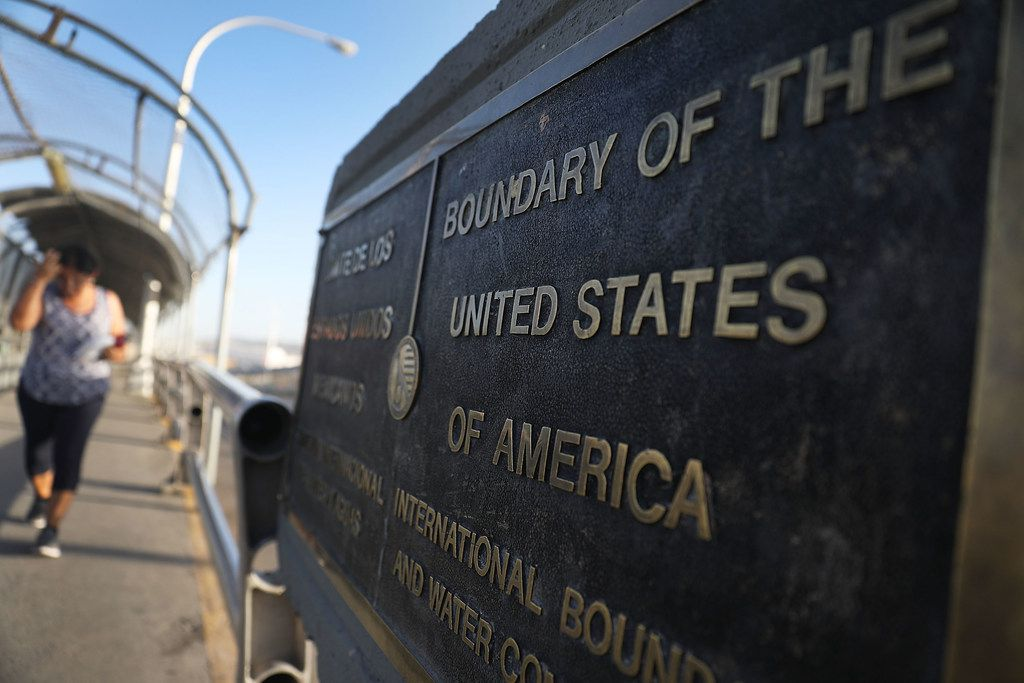 A plaque marks the U.S. border on the Paso Del Norte Port of Entry bridge connecting the U.S. and Mexico.