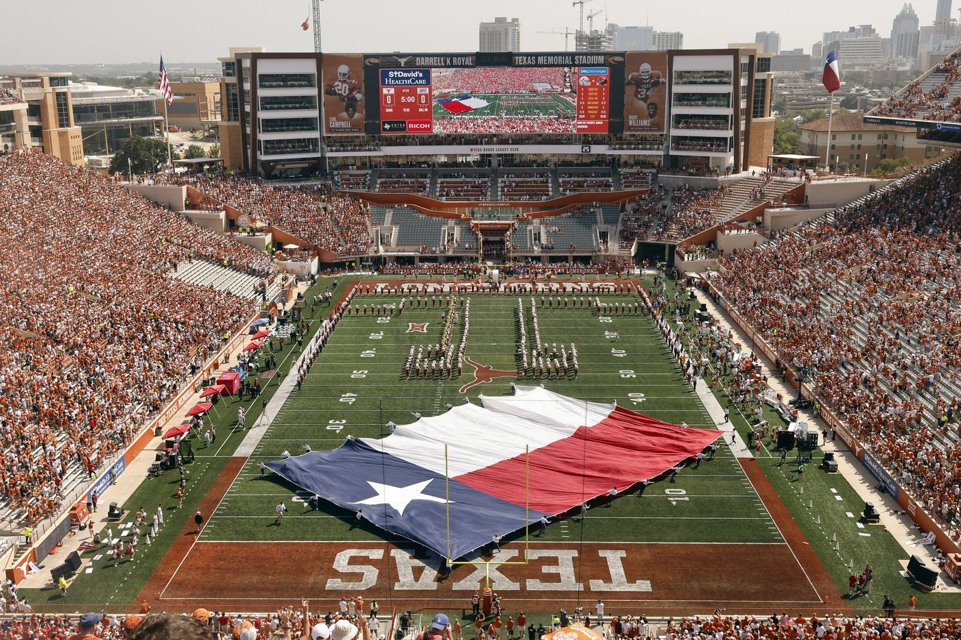 The Texas flag is spun around on the DKR-Texas Memorial Stadium before kickoff in Austin, Saturday, September 4, 2021. The Longhorns were facing the Louisiana-Lafayette Ragin Cajuns in the season opener. (Tom Fox/The Dallas Morning News)