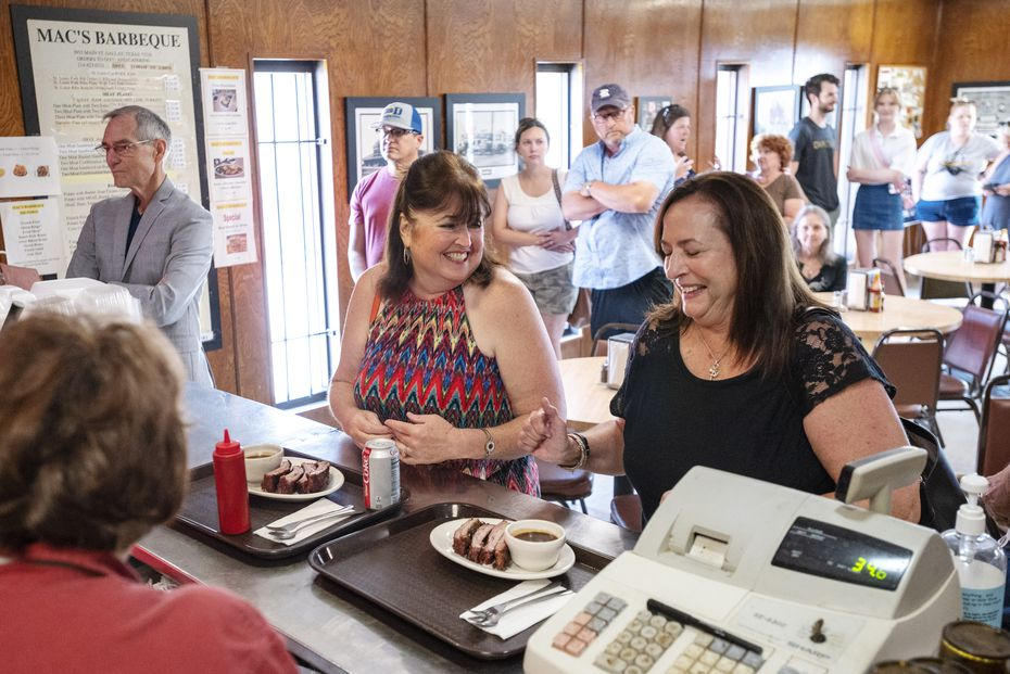 Longtime customers Andrea Houghton, center, and Laurie Shaver, right, joke with employee Debra Schultz before paying for their order at Mac's Bar-B-Que in Dallas.