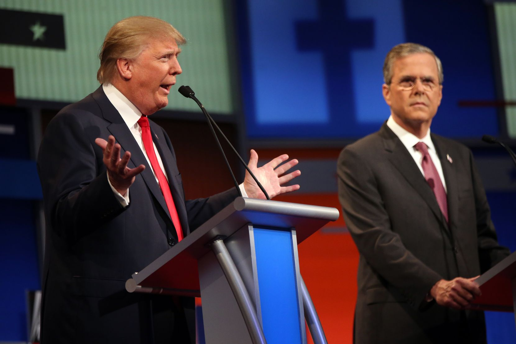 Donald Trump and Jeb Bush compete in the Fox News Channel Republican presidential debate at Cleveland's Quicken Loans Arena on Aug. 6, 2015.