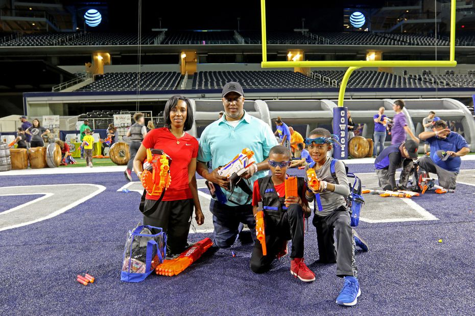 Chemene Pope, left, and her husband Joseph Pope brought their children Ryan Pope, right, and Zachary Pope to Jared's Epic Nerf Battle 3. They each had their own toy guns.