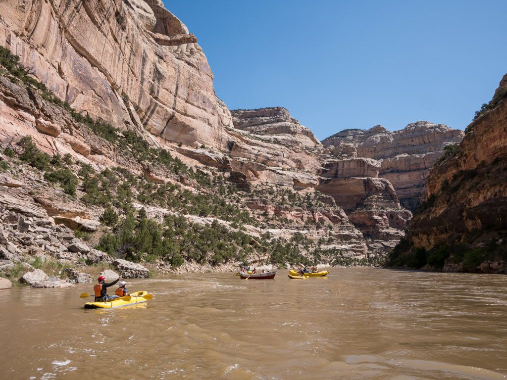 Rafts and duckies float the Yampa through Dinosaur National Monument.  The sandstone walls here were laid down long before the time of the dinosaurs. Rafts and duckies float the Yampa through Dinosaur National Monument.  The sandstone walls here were laid down long before the time of the dinosaurs.