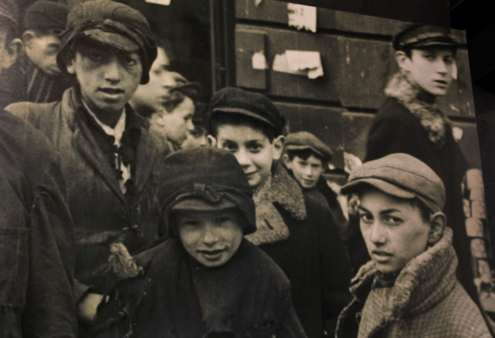 Holocaust survivor Max Glauben (center//third from left, partially obscured) is pictured with other boys in the Warsaw Ghetto prior to his family's deportation to the concentration camps. (Courtesy of Dallas Holocaust and Human Rights Museum)
