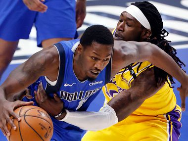 Los Angeles Lakers center Montrezl Harrell (15) purposely fouls Dallas Mavericks forward Dorian Finney-Smith (10) during the fourth quarter at the American Airlines Center in Dallas, Thursday, April 22, 2021. (Tom Fox/The Dallas Morning News)