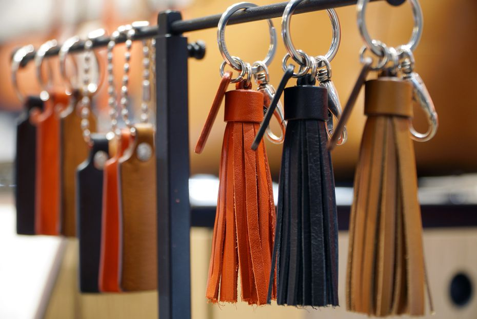 Leather tassels can include charms and pendants.