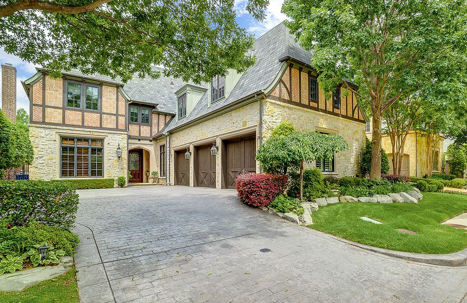 Priced at $1,299,900, the estate at 79 Abbey Woods Lane in Dallas offers recent transitional updates, an elevator and a pool.