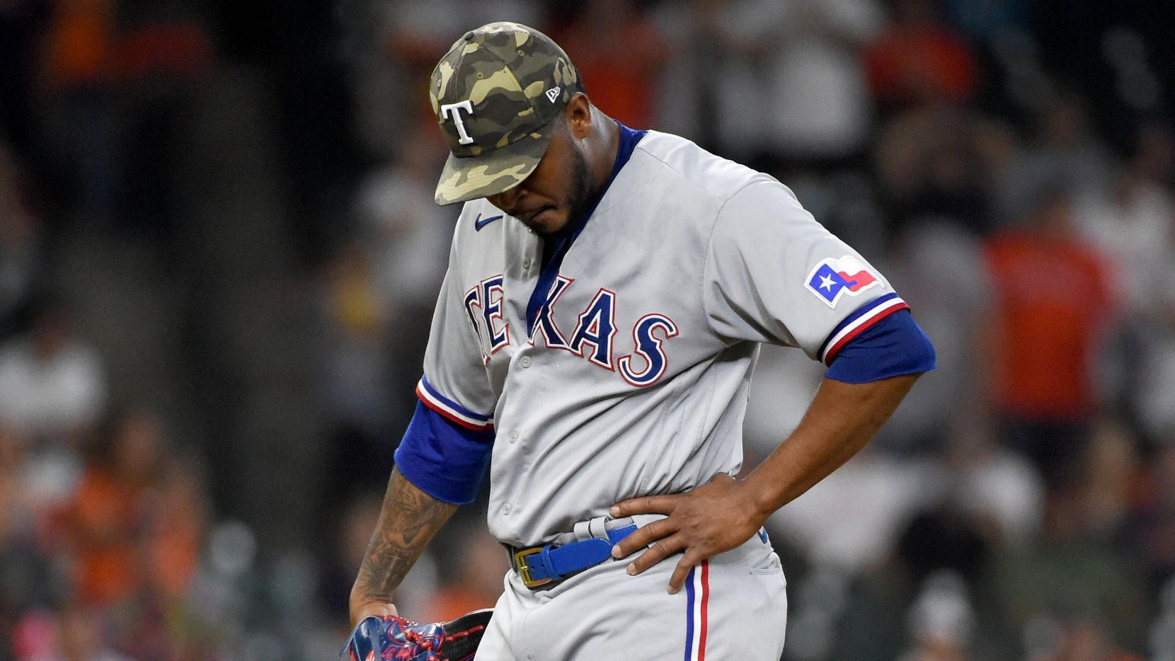 Texas Rangers relief pitcher Joely Rodriguez reacts after giving up a two-run single during the eighth inning of a baseball game, Sunday, May 16, 2021, in Houston. (AP Photo/Eric Christian Smith)