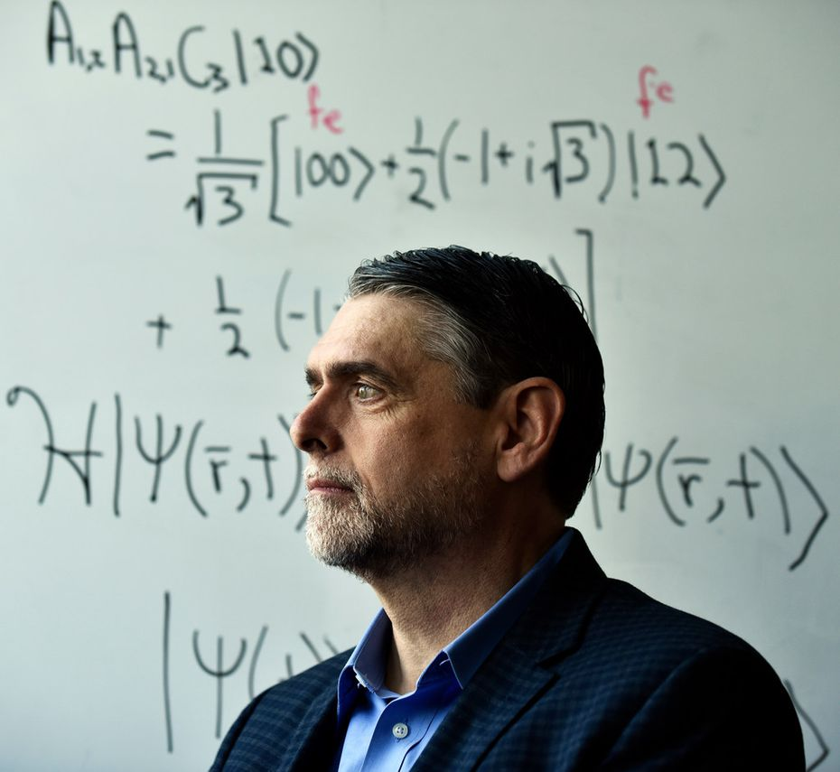 Some of the nation's most advanced work in quantum computing is being done in Texas, including at Southern Methodist University under the guidance of  professor Mitch Thornton, shown in the university's Caruth Hall near a wall filled with quantum equations.