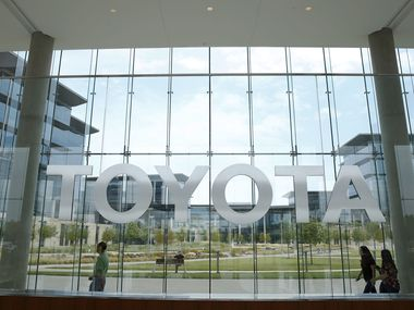 Toyota employees walk by the lobby area at Toyota Motors North America in Plano on Friday, July 27, 2018. Toyota will lift its mask requirement for fully vaccinated employees at its 100-acre campus in Plano beginning on July 12.
