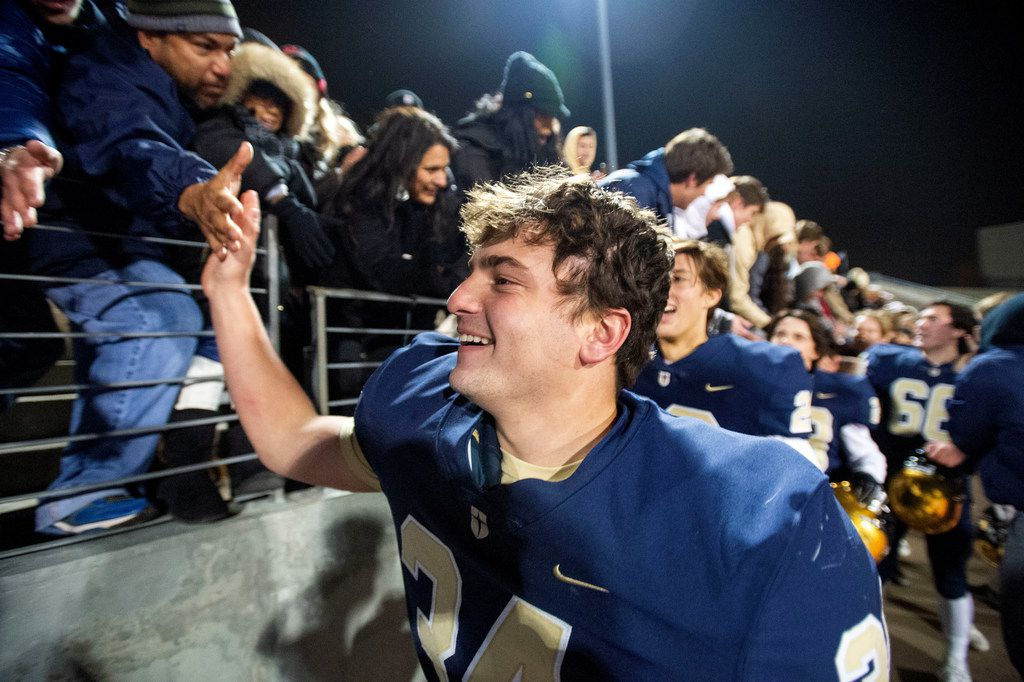 Jesuit sophomore defensive lineman Nico Boyd (34) celebrates with fans after his team's 27-25 victory over defending state champions Longview in an area round high school football playoff game on Friday, November 22, 2019 at John Kincaide Stadium Dallas. (Jeffrey McWhorter/Special Contributor)