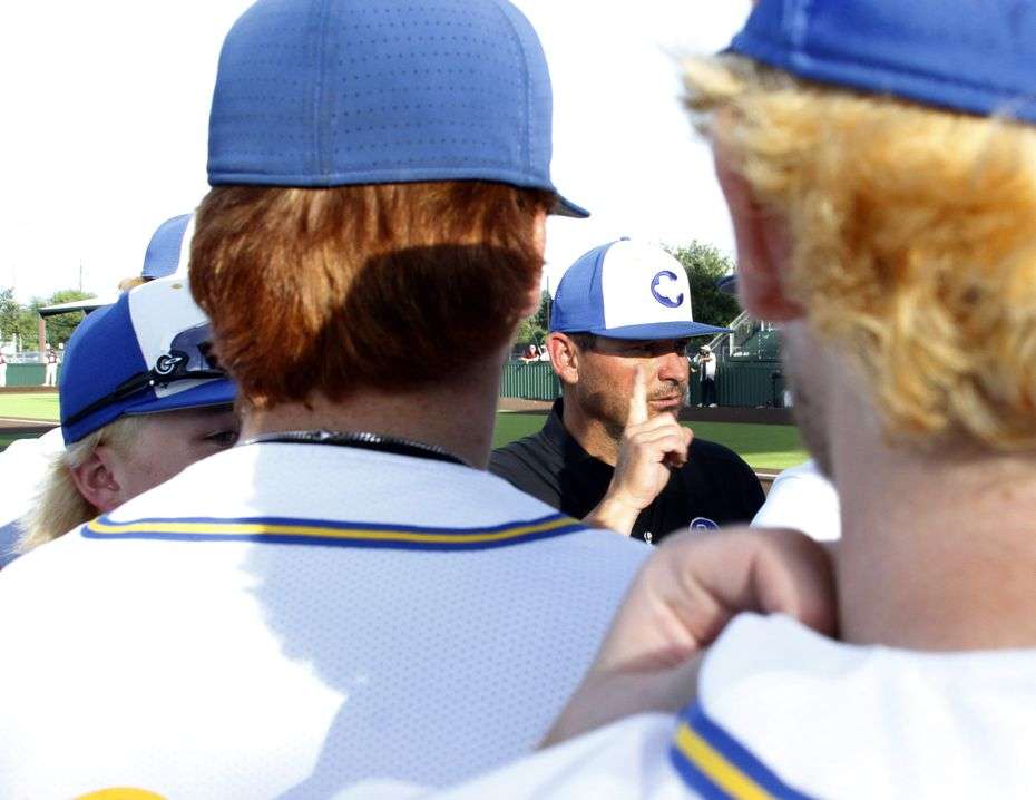 Corsicana head coach Heath Autrey speaks with his players prior to the start of their game against Ennis. Autrey, whom has recently overcome throat cancer, led his team against Ennis in their playoff baseball game held at Duncanville High School in Duncanville on May 20, 2021. (Steve Hamm/ Special Contributor)