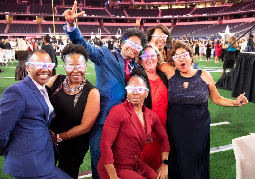 Children's Health workers celebrated milestone anniversaries at the company's Paint the Town RED Anniversary Gala at AT&T Stadium last year.