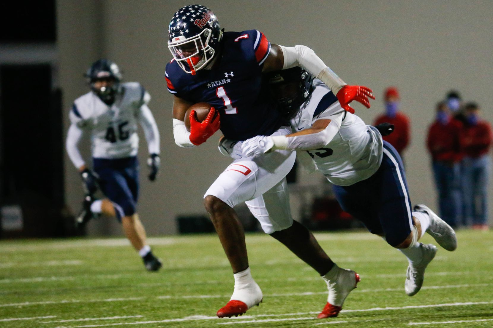 Denton Ryan's Ja'tavion Sanders (1) is tackled during the first half of a football game against Frisco Lone Star at the C.H. Collins Complex in Denton on Thursday, Dec. 4, 2020. The game is tied at halftime, 14-14. (Juan Figueroa/ The Dallas Morning News)