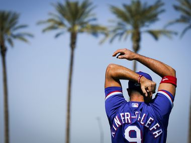 Texas Rangers infielder Isiah Kiner-Falefa stretches before a spring training game against the Cincinnati Reds at Goodyear Ballpark  on Monday, Feb. 24, 2020, in Goodyear, Ariz.