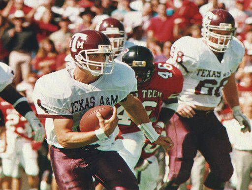 ORG XMIT: LUB102 [a&m 100393]  Headline: COREY PULLIG SHAWN BANKS Caption: Texas A&M quarterback Corey Pullig (4) takes off on a  short run during the Southwest Conference game against Texas Tech  University Saturday, Oct. 2, 1993, in Lubbock, Texas. Chasing Pullig is Tech linebacker Shawn Banks (46). (AP Photo/Avalanche- Journal, Joe Don Buckner) Photographer: DON BUCKNER  Credit: AP  City: LUBBOCK  State: TX  Country: USA  Date: 19931002 Time: 145515+0000  ObjectName: a&m 100393 CaptionWriter: PEN KLW JDB  Special: uncheck proportions and set height to 116.000 percent Category: S  SupCat1: $C  SupCat2: FBC  Source: AVALANCHE-JOURNAL  Keyword: A&M 100393