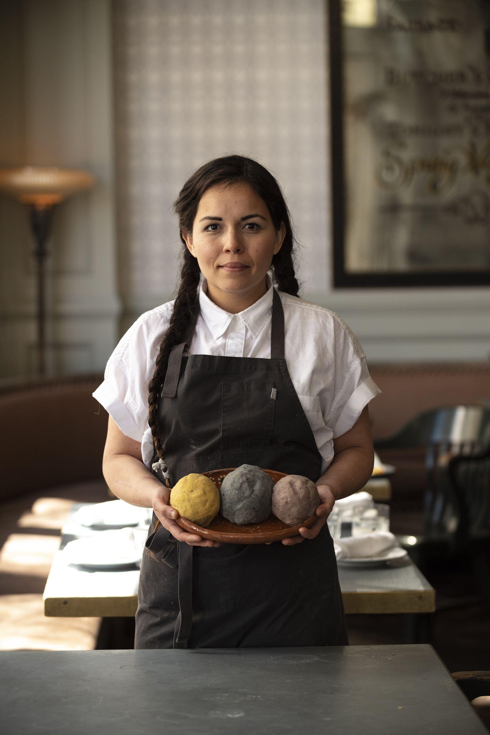 Chef Olivia Lopez in Dallas with hand-made balls of heirloom corn masa